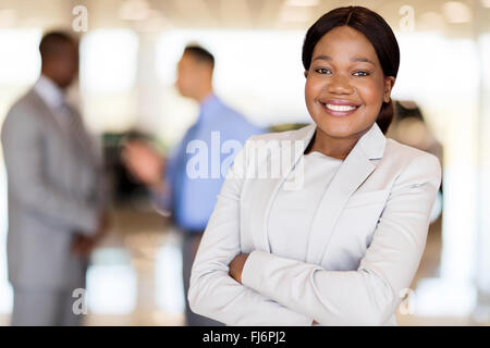 close up portrait of African America businesswoman at car dealership - Stock Image