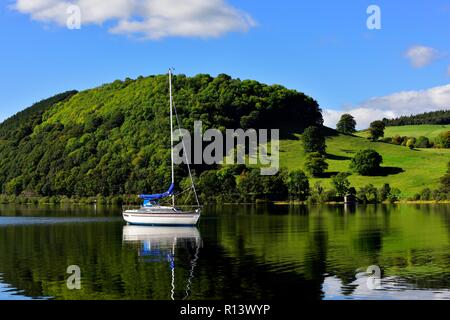A Yacht on Ullswater Lake,Lake District National Park,Cumbria,England,UK - Stock Image