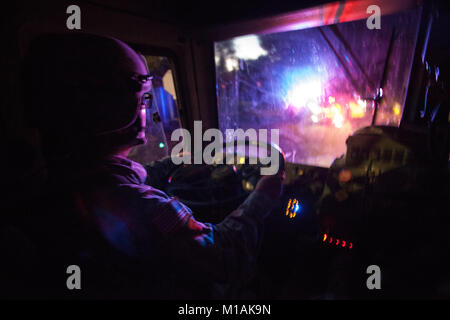 Sgt. Diana Martinez, a transportation specialist with Detachment 1, 1114 Composite Transportation Company, in Van - Stock Image