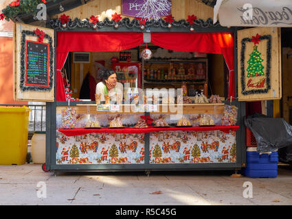 Zadar, Croatia, November 28, 2018: Fritule (mini donuts) stand (also selling drinks: Juices, Water and cakes).  Advent market in town square - Stock Image