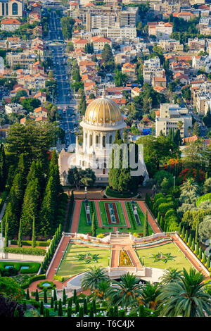 Israel, Haifa District, Haifa. Baha'i Gardens and the Shrine of the Bab, and buildings in downtown Haifa seen from Mount Carmel. - Stock Image