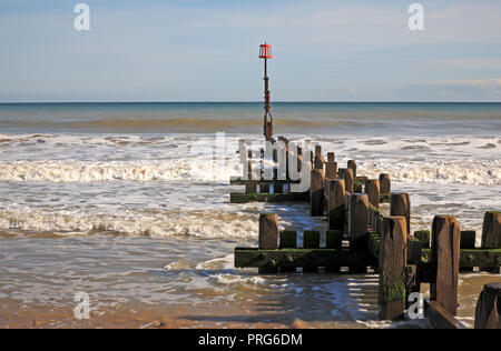 A wooden timber breakwater and marker post on the east beach at Mundesley, Norfolk, England, United Kingdom, Europe. - Stock Image