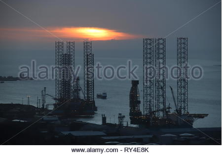 Jack up rigs at Port of Dundee at dawn Scotland  March 2019 - Stock Image