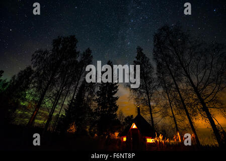 Night landscape with stars and small hut - Stock Image