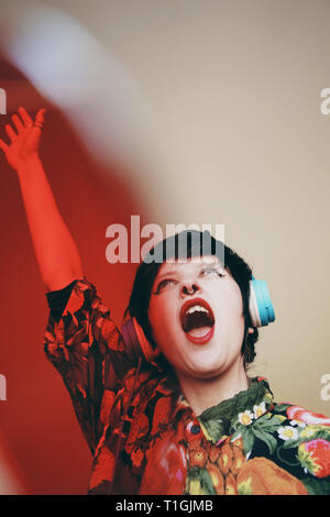 Female dj with a retro wear style - Stock Image