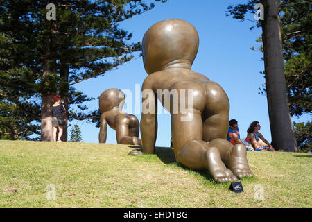 Giant baby sculptures at the 2015 Sculpture By The Sea event at Cottesloe Beach, Perth. Western Australia - Stock Image