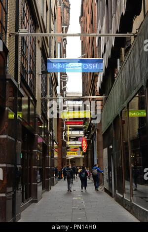 Colourful overhead signs in the narrow Mitchell Lane, Glasgow, Scotland, UK - Stock Image