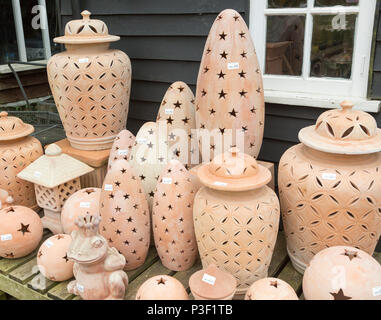 Display of clay lanterns on sale, The Walled garden plant nursery, Benhall, Suffolk, England, UK - Stock Image