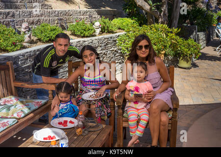 Hispanic family, mother, father, children, daughters, pool party, Castro Valley, Alameda County, California, United - Stock Image