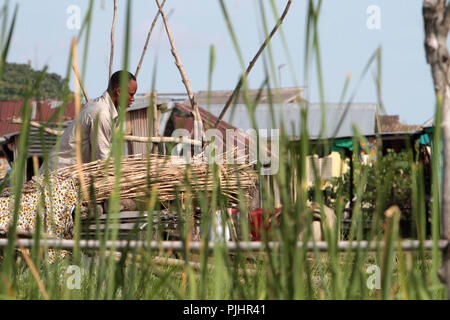 Work of a Beninese farmer. Lakeside town. Lake Nokoue. Ganvie. - Stock Image