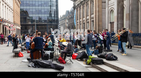 Singers and musicians from the Nevis Ensemble, 'Scotland's Street Orchestra' performing in Royal Exchange Square, Glasgow, Scotland, UK - Stock Image
