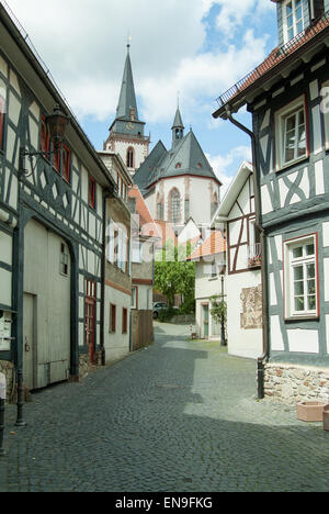 narrow street leading to the church - Stock Image