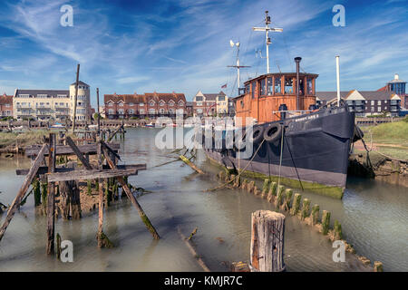 Littlehampton, seaside town on the Sussex coast and estuary of the River Arun. House boat mooring - Stock Image