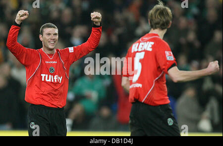 Vinicius (L) and Thomas Kleine of Hanover celebrate the victory after the Bundesliga match Hanover 96 vs Werder - Stock Image