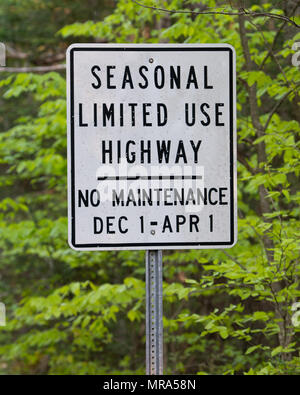Seasonal limited use highway sign on a woods road in the Adirondack Mountains, NY USA - Stock Image
