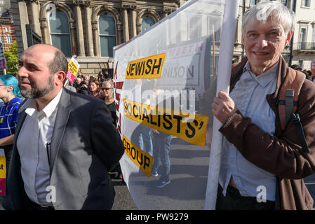 London, UK. 13th October 2018.    People with the Jewish Socialist Group banner at the rally in London to oppose racism  and fascism close to where the racist, Islamophobic DFLA were ending their march on Whitehall bringing together various groups to stand in solidarity with the communities the DFLA attacks. The event was organised by Stand Up To Racism and Unite Against Fascism. Peter Marshall/Alamy Live News - Stock Image