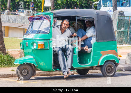 Colombo, Sri Lanka - March 16th 2011:  Tuk Tuk drivers waiting for business. They are a cheap way of getting around the city. - Stock Image