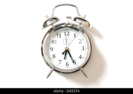 Chrome alarm clock with bells on, set just after 6-25. - Stock Image