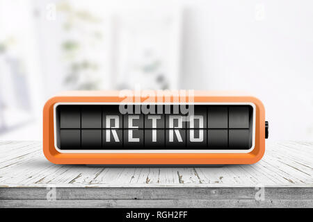 Retro alarm clock with a message on a wooden table in a bright living room - Stock Image