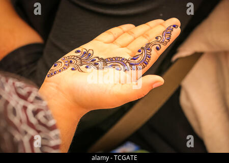 Trafalgar Square, London, UK, 08th June 2019. Mehndi decorative henna colour is popular with visitors to the stalls. Thousands of Londoners and visitors come together on Trafalgar Square to celebrate the end of Ramadan and Eid Festival, as well as London's rich cultural diversity. The festival is hosted by Mayor of London Sadiq Khan. - Stock Image