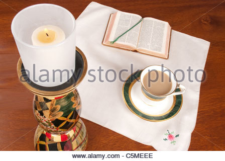 Having coffee while reading the Bible - Stock Image