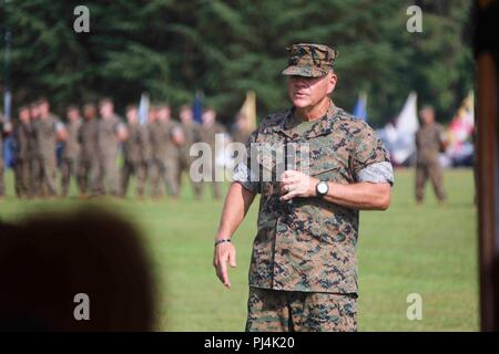 Commandant of the U.S. Marine Corps Gen. Robert B. Neller speaks during a change of command ceremony on Marine Corps Base, Quantico, Va., Aug. 28, 2018. Lt. Gen. Robert S. Walsh relinquished command of Marine Corps Combat Development Command and Combat Development and Integration to Lt. Gen. David H. Berger. (U.S. Marine Corps photo by Sgt. Olivia G. Ortiz) - Stock Image