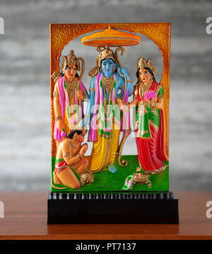 Small moulded plastic, standalone Ram Darbar sculpture, a Hindu religious artefact with Sri Ram, Sita, Lakshman and Hanuman the monkey god. Ramayana, - Stock Image