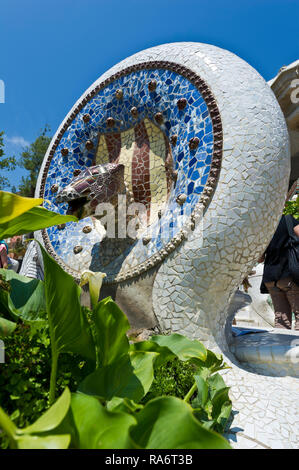 An animal head made of ceramic on display at the Park Guell designed by Antoni gaudi, Barcelona, Spain - Stock Image