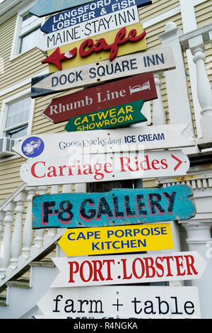 Directional advertising panels for local businesses in Kennebunkport, Maine, USA. - Stock Image