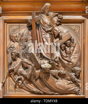 COMO, ITALY - MAY 8, 2015: The carved wooden relief of Last Judgment on the pulpit of church Santuario del Santissimo Crocifisso. - Stock Image