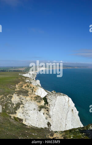 The white chalk cliffs of Tennyson Down on the Isle of Wight looking across Freswater Bay - Stock Image