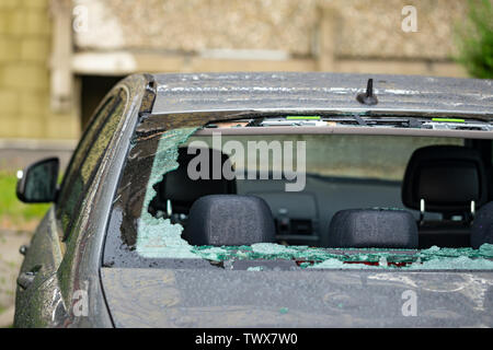 Hail damage to rear window after a severe thunderstorm - Stock Image