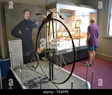 Portrait of Fred Spalding Junior with is penny farthing bicycle, inside Chelmsford Museum, Chelmsford, Essex, UK - Stock Image