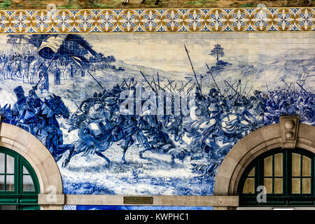Porto, Portugal, August 15, 2017: Sao Bento railway station's azulejo panel by Jorge Colaco circa 1916, depicting - Stock Image