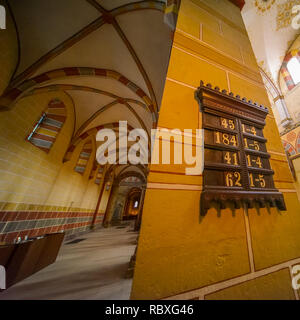 Koenigslutter, Germany, January 3., 2019: Interior view of the cathedral with a column on which the numbers of the hymns for the most powerful divine  - Stock Image