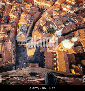 Bologna, aerial view of city and Garisenda from Asinelli Tower - Stock Image