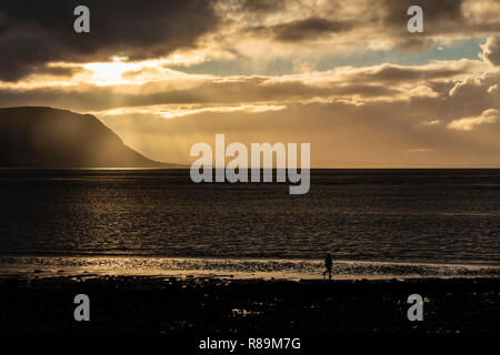 Sunset with clouds over the Irish Sea at Llandudno West Shore, North Wales - Stock Image