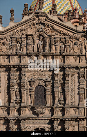 The Baroque Churrigueresque style Josephine entryway on the Iglesia del Carmen church and convent in the historic center on the Plaza del Carmen in the state capital of San Luis Potosi, Mexico. - Stock Image