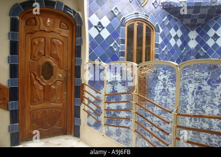 Barcelona Casa Batllo stairway with luxery door and blue tile  - Stock Image