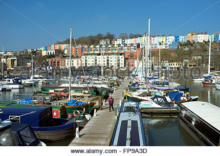 Colourful housing in Hotwells opposite a marina full of leisure boats. Bristol Floating Harbour, UK. - Stock Image