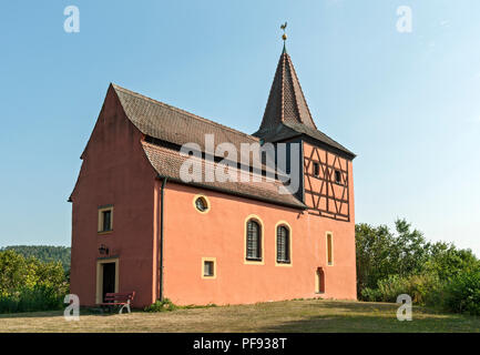 Small red church on a hill, Bavaria, Germany. - Stock Image