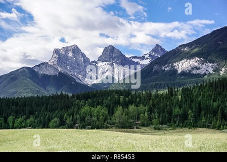 A view of the Three Sisters Mountain looking up from the ​trail. - Stock Image