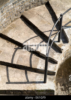 UK England, Dorset, Lyme Regis. shadow of handrail up seafront defence steps - Stock Image
