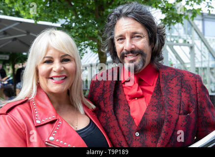 London, UK. 20th May, 2019. Laurence Llewelyn-Bowen and his wife Jackie Bowen attend RHS Chelsea Flower Show Press Day which takes place before it officially opens tomorrow until Saturday 25th May. The world renowned flower show is a glamourous, fun and an educational day out which is attended by many celebrities. There are many gardens, floral displays, Marquees all set in the glorious grounds of The Royal Hospital Chelsea. Credit: Keith Larby/Alamy Live News - Stock Image