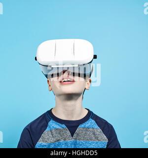 boy 10yo wearing VR headset, VR Glasses - Stock Image