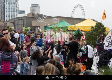 Climate Change activists with Extinction Rebellion campaign for a better future for planet Earth after blocking Waterloo Bridge and as part of a multi-location 5-day Easter protest around the capital, on 16th April 2019, in London, England. - Stock Image