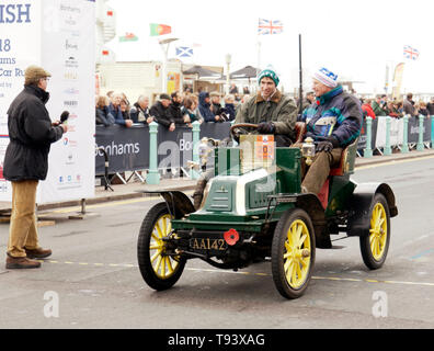 Mr Will Clarke driving a 1903 Napoleon,  across the finishing line of the 2018 London to Brighton Veteran Car Run. - Stock Image