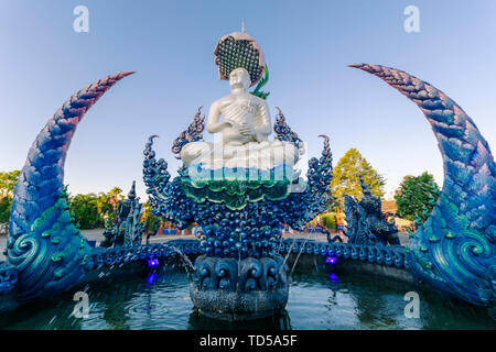 Fountain outside Wat Rong Suea Ten (Blue Temple) in Chiang Rai, Thailand, Southeast Asia, Asia - Stock Image