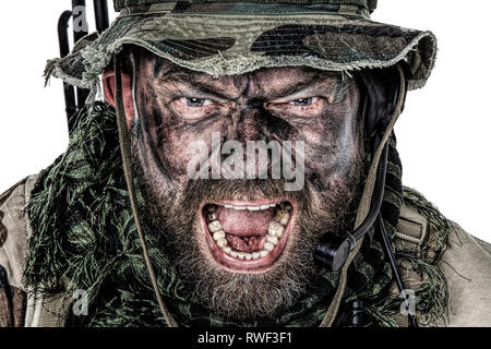 Close-up portrait of a U.S. commando yelling. - Stock Image