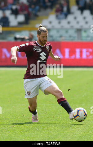 Turin, Italy. 14th Apr, 2019.  Serie A football, Torino versus Cagliari; Cristian Ansaldi of Torino FC plays the ball through the midfield Credit: Action Plus Sports Images/Alamy Live News - Stock Image